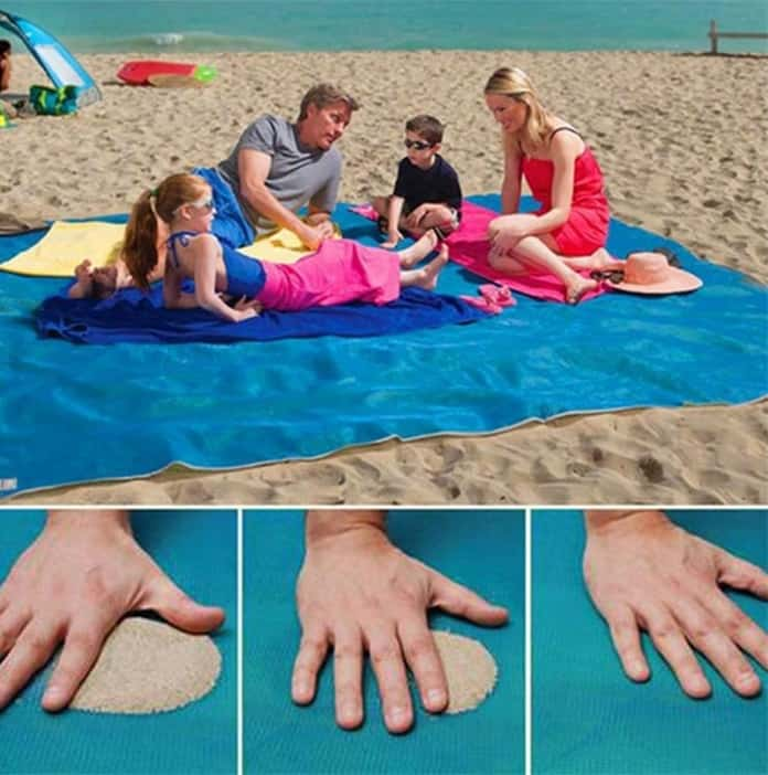 picture contains a family lying on a beach mat