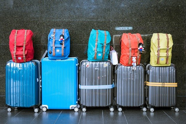 A bunch of luggage sitting on top of a suitcases