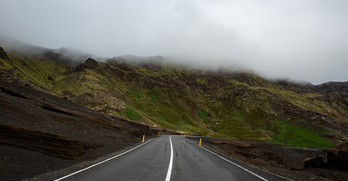 A road with a mountain in the background