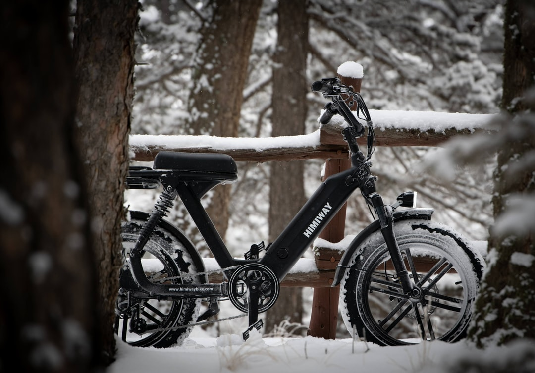 A bicycle covered in snow