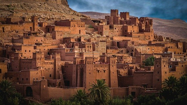 A castle like building with Aït Benhaddou in the background